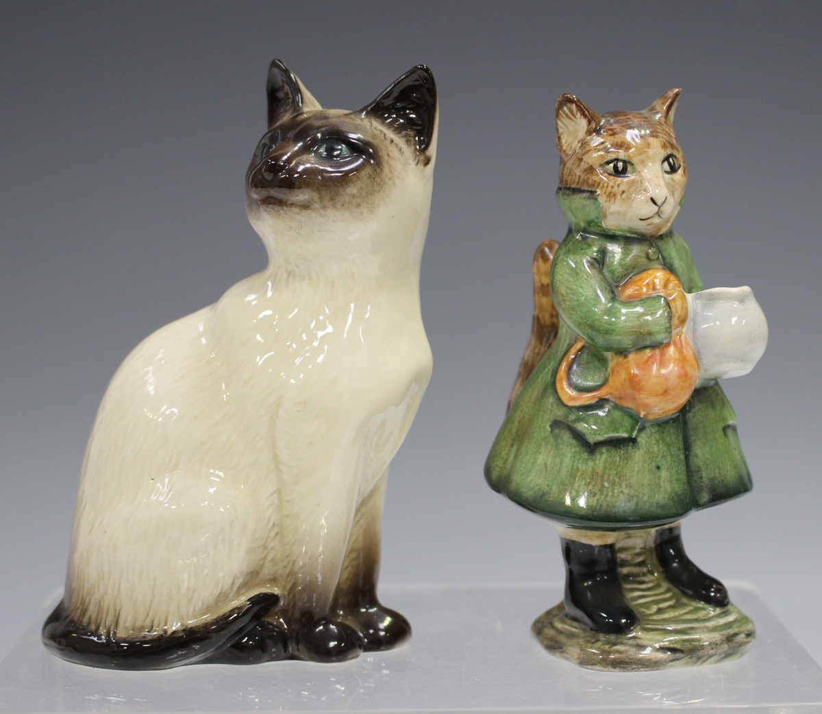 A Beswick Beatrix Potter's figure of Simpkin, mark BP-3b, together with a Royal Doulton Siamese Cat,