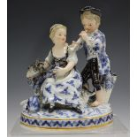 A Meissen figure group representing Autumn, late 19th century, modelled after Schönheit as a girl