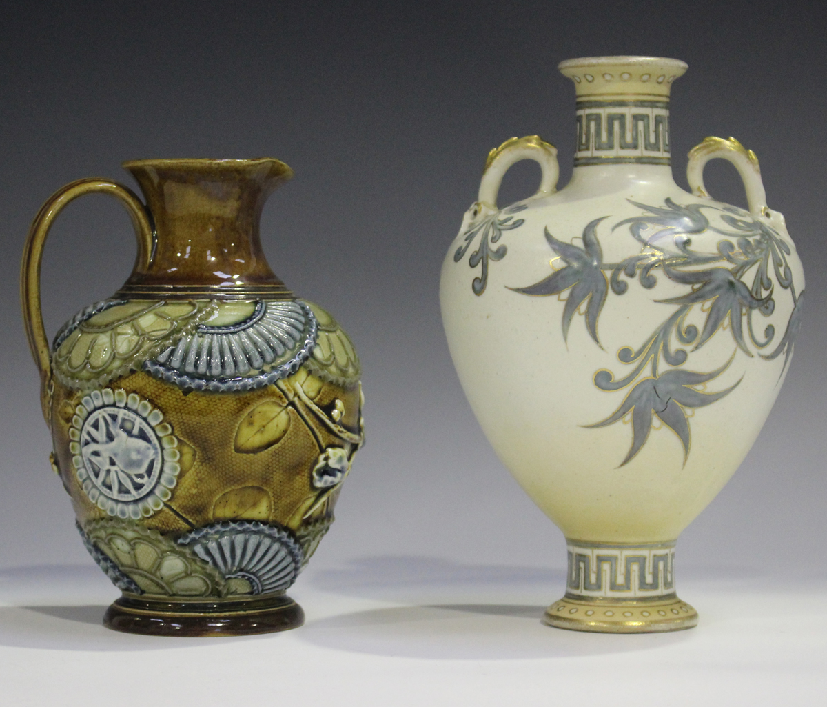 A Doulton Lambeth stoneware jug, 1880-1891, decorated in relief with flowers and stylized fan