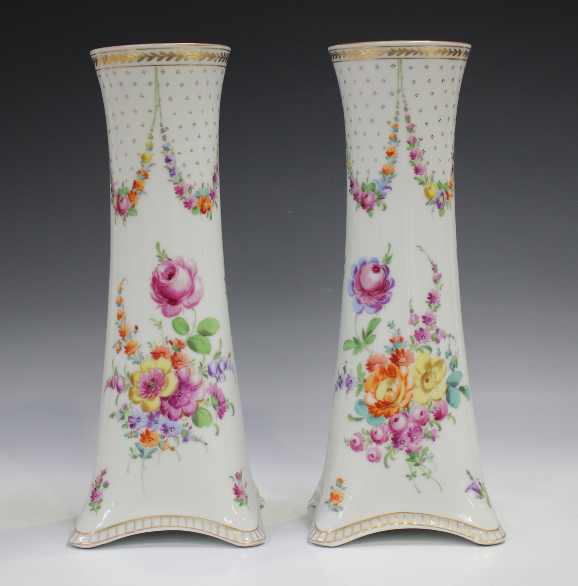 A pair of Dresden porcelain vases, mid-20th century, of cylindrical shape rising from square