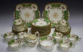 A Coalport porcelain part tea service, late 19th century, decorated with floral sprays within gilt