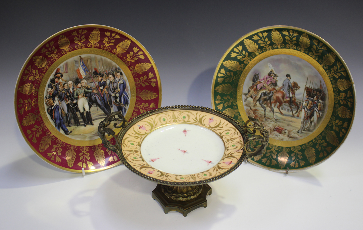 A gilt metal mounted porcelain tazza, late 19th/early 20th century, the apricot rimmed dish with