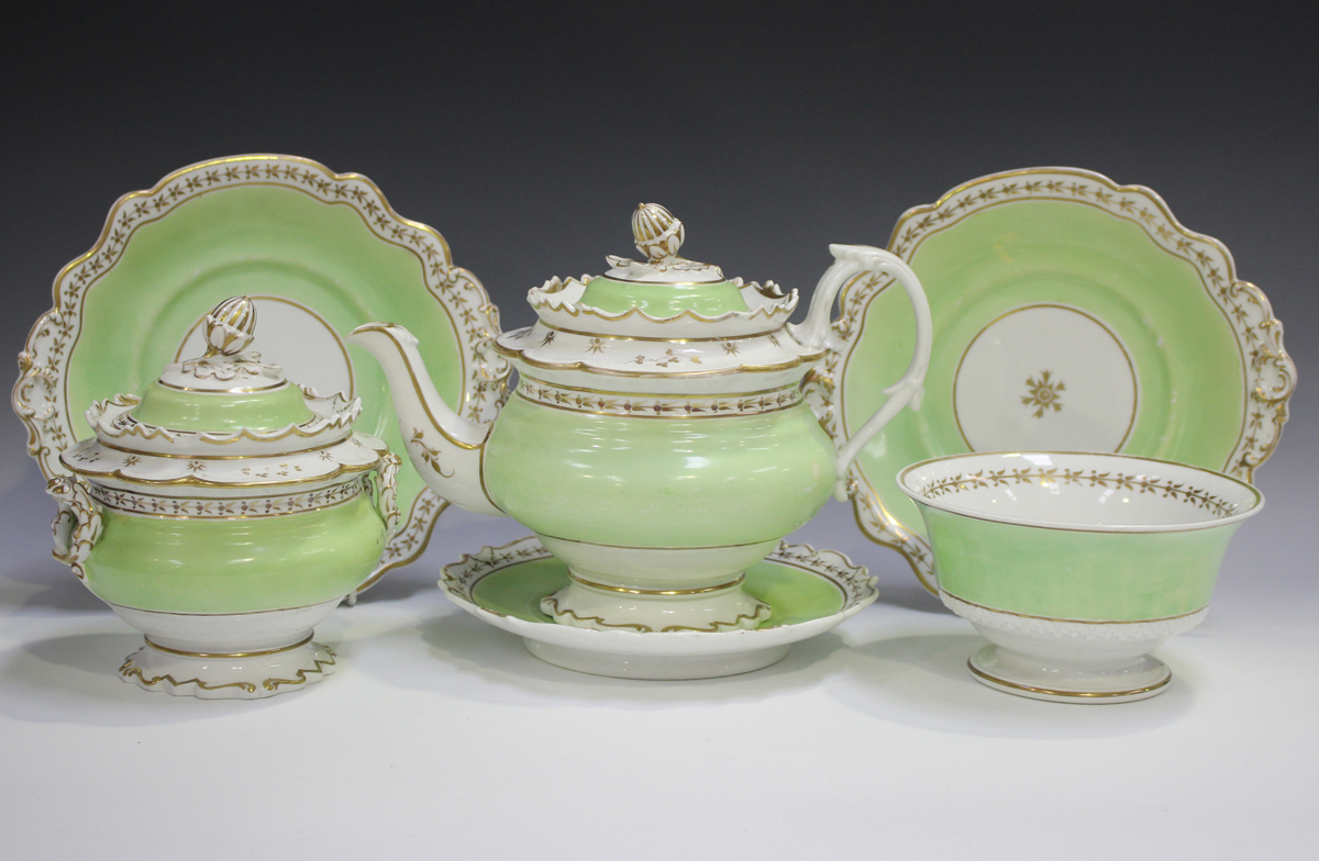 A John Ridgway porcelain part tea service, circa 1835-40, with green borders and gilt foliate
