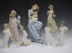Four Lladro figures, including Chit Chat, No. 5466, together with seven Nao figures.Buyer's