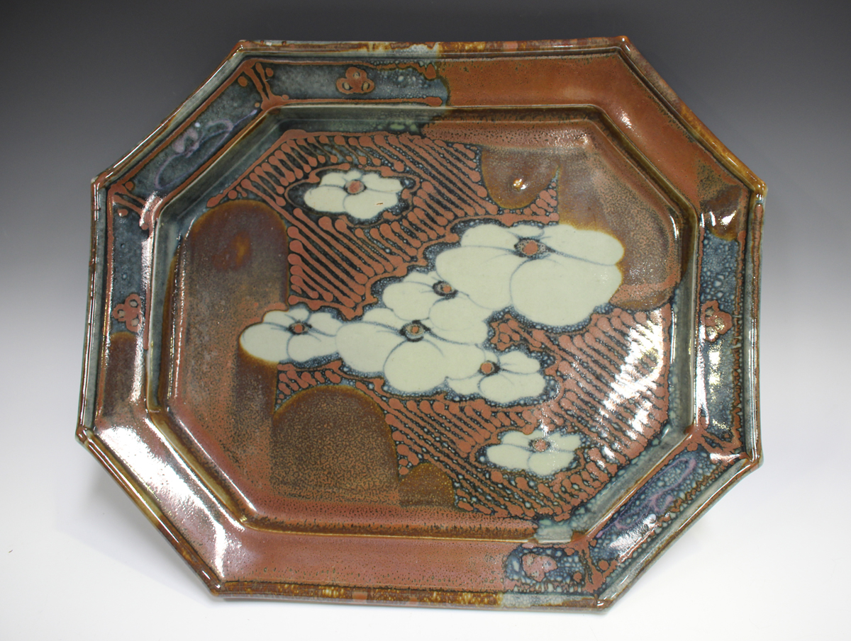 A David Frith studio pottery octagonal footed dish, the mottled blue and red/brown ground