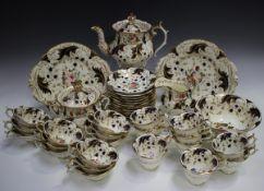 A Rockingham part tea service, circa 1830-42, with three-spur handles, pattern No. 1316,