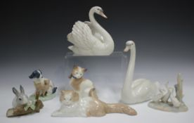 Two Lladro swans, comprising Swan with Wings Spread, No. 5231, and Graceful Swan, No. 5230, together