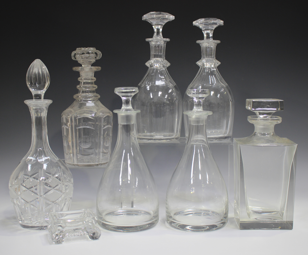 Seven glass decanters and stoppers, 19th and 20th century, four with cut detail, including two