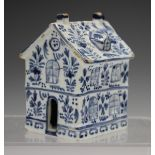 A Dutch Delft model of a house, late 19th century, the two-storey building painted in blue with