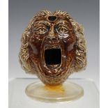 A rare Fulham stoneware quill holder, 19th century, modelled in the form of a man's head with open