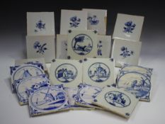 A group of approximately sixty Dutch Delft blue and white tiles, late 19th/early 20th century,