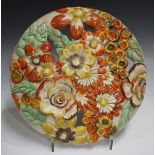 An Art Deco Clarice Cliff pottery circular wall charger, moulded and pierced with a dense