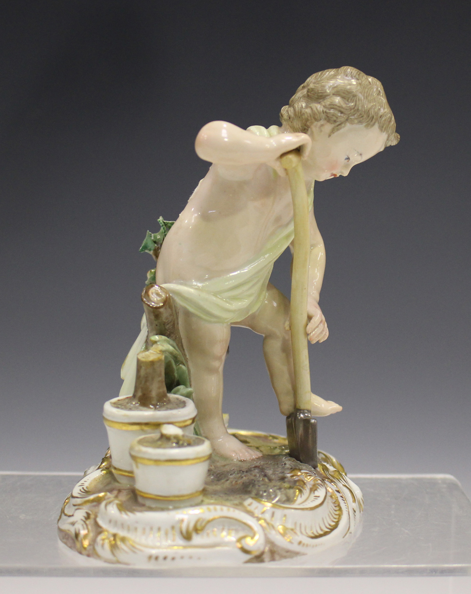 A Meissen figure of a putto gardener, late 19th century, modelled digging with a spade, a rake and - Image 5 of 7