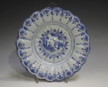 A Delft moulded dish, 18th century, painted in blue with a chinoiserie style figure within a