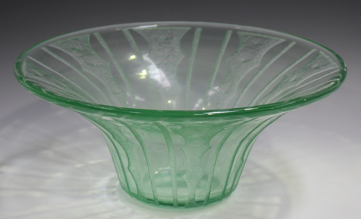 A Daum Nancy pale green tinted wide rimmed bowl, circa 1930, with acid etched geometric