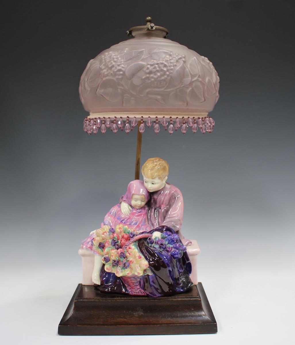 A Royal Doulton figure group lampbase, The Flower Seller's Children, HN1206, raised on a rectangular