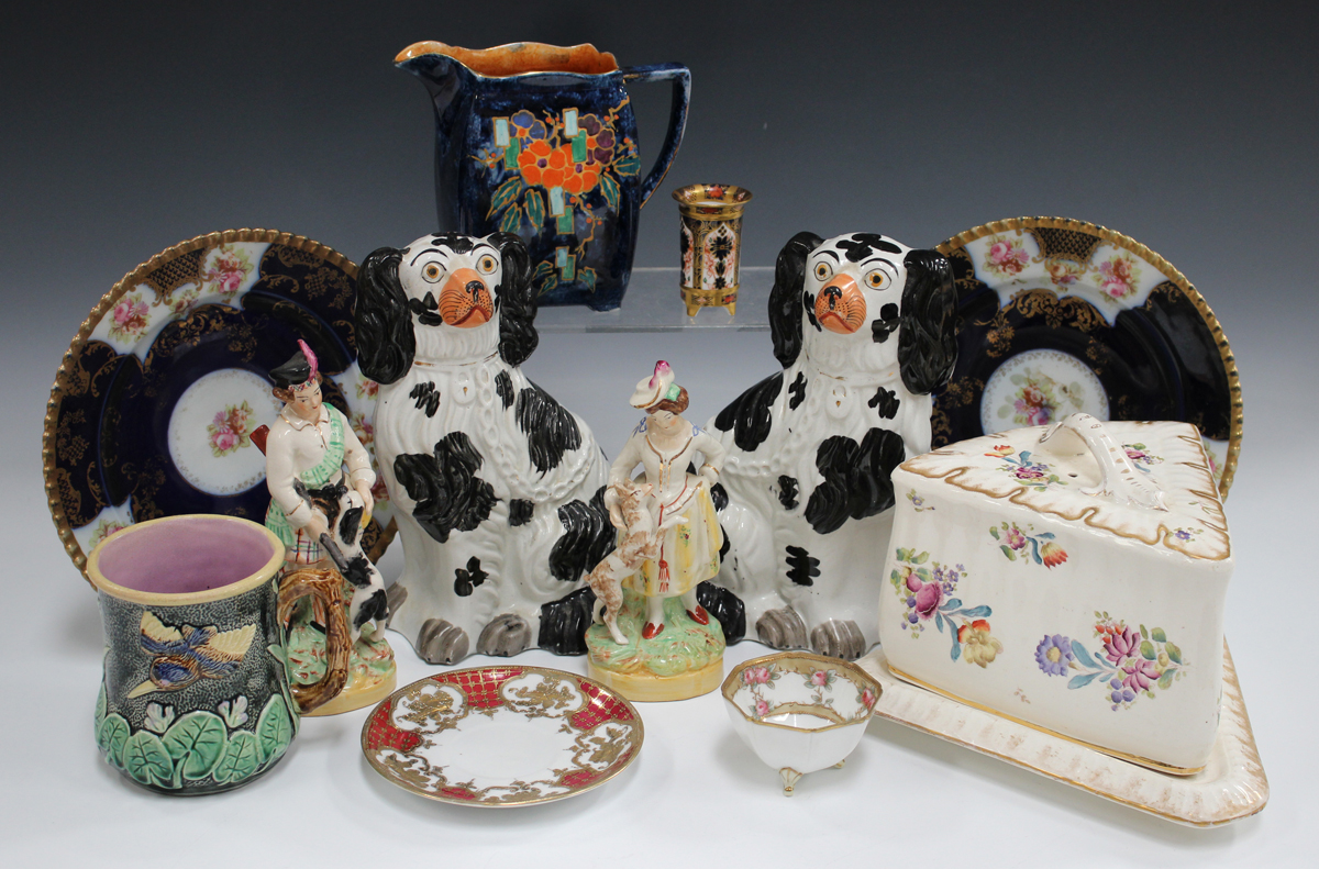 A small group of pottery and porcelain, late 19th and 20th century, including a pair of