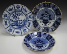 Three Dutch Delft chargers, mid to late 18th century, comprising one painted with a chinoiserie
