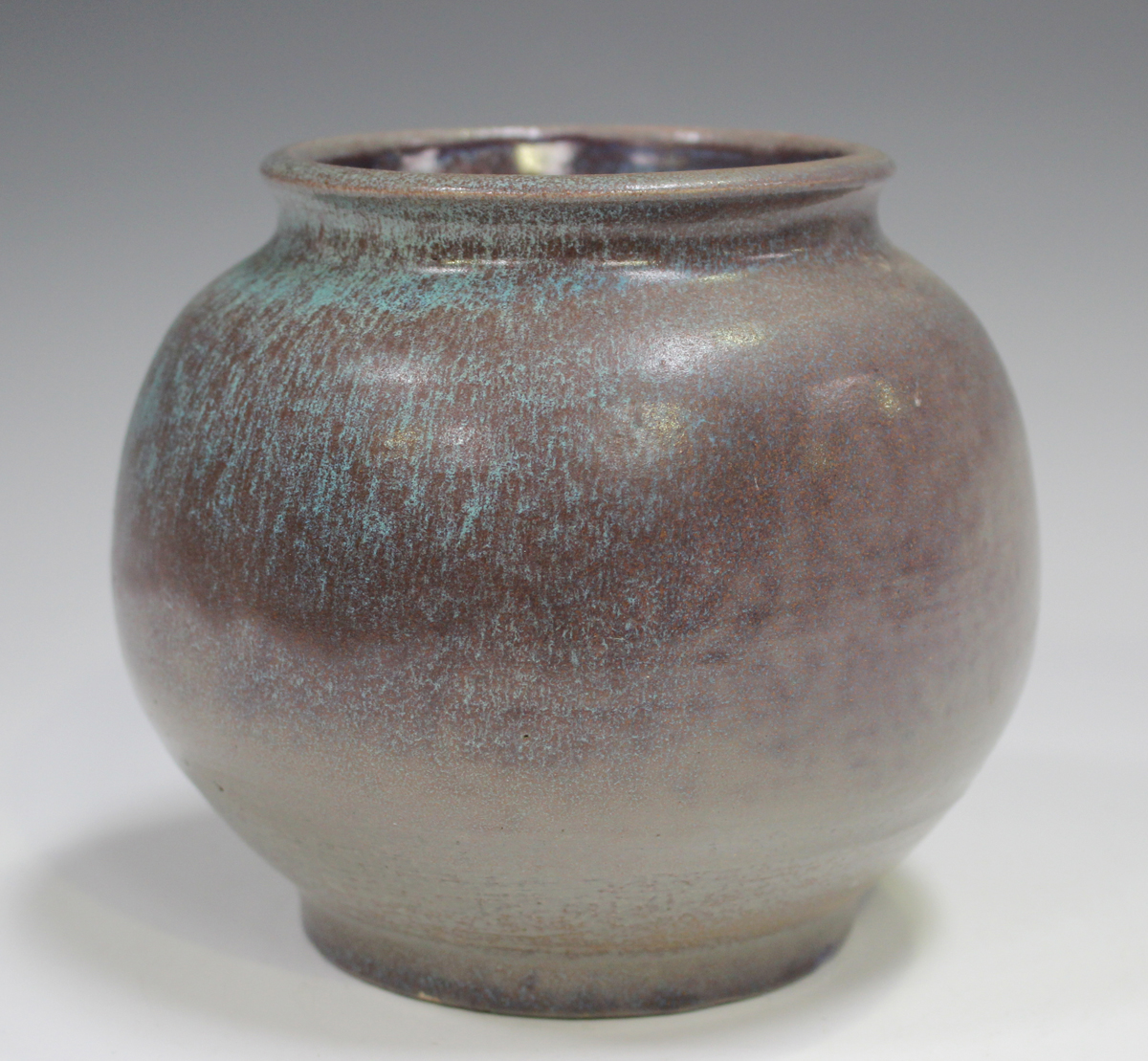 A studio pottery vase, early 21st century, of bulbous form, covered in a streaky purple and pale