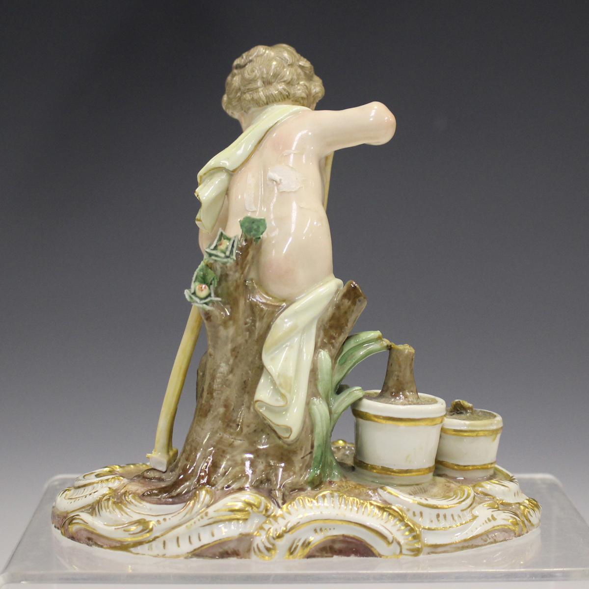 A Meissen figure of a putto gardener, late 19th century, modelled digging with a spade, a rake and - Image 6 of 7
