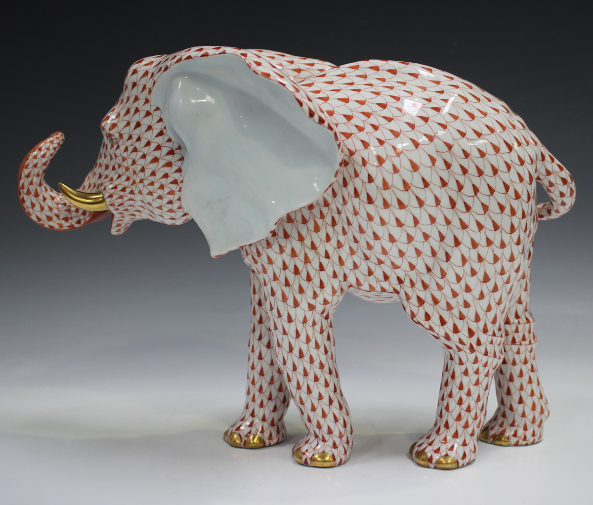 A large Herend porcelain elephant with iron red scale decoration, impressed and printed marks to - Image 3 of 3