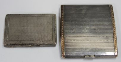 A George V silver cigarette case of rectangular form with engine turned decoration and gold borders,