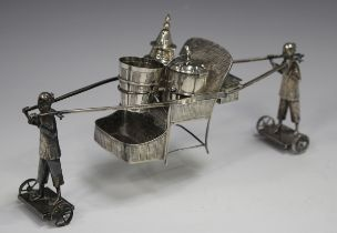 An early 20th century Chinese silver condiment stand, modelled in the form of two standing figures
