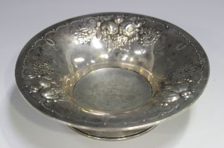 A Norwegian .830 silver circular dish by David Andersen, the flared rim embossed with fruit, on a