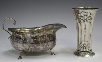 An Art Nouveau silver spill vase, embossed with three vertical panels of stylized flowerheads and