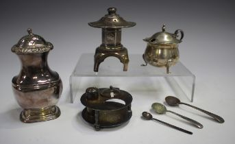 A Japanese sterling silver pepper caster in the form of a stone lantern, height 7.5cm, together with