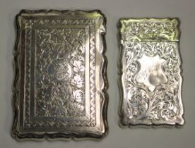 A Victorian silver shaped rectangular card case, engraved with leaves, Birmingham 1882 by Cohen &