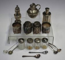 A Chinese silver four-piece condiment set, each piece of cylindrical form, a Chinese silver pepper