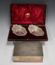 A pair of late Victorian silver shaped oval bonbon dishes with pierced and embossed lattice and