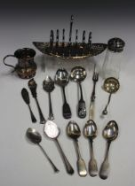A small group of silver and plated items, including a silver topped glass sugar sifter, Sheffield