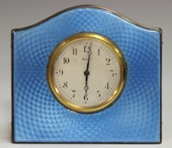 An Art Deco silver and pale blue enamelled bedside timepiece, the silvered dial with Arabic hour