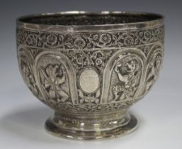 A late 19th century Burmese silver rose bowl, the body decorated in relief with a band of arched