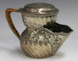An Edwardian silver shaving mug, the spiral fluted body decorated with foliate scrolls, the spout