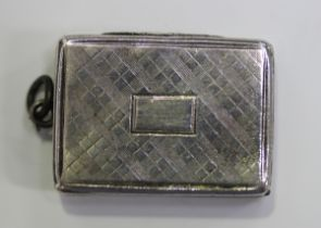 An early Victorian silver vinaigrette of rectangular outline, the exterior engraved with a tartan