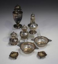 An Edwardian silver sugar caster of urn form with pierced dome cover, on a circular foot, London