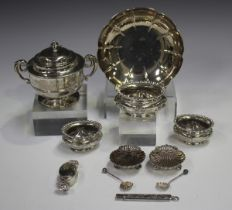 A pair of Victorian silver scallop shell salts, each raised on ball feet, with matching salt spoons,
