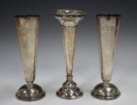 A pair of Elizabeth II silver specimen vases, each on a domed circular foot, Sheffield 1953, by