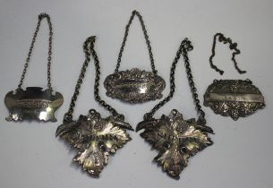 A pair of Victorian silver decanter labels, each of vine leaf form, pierced with 'Madeira' and '