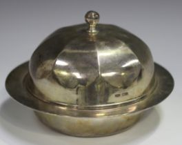 A George V silver muffin dish, liner and domed cover with octagonal knop finial, Sheffield 1930 by