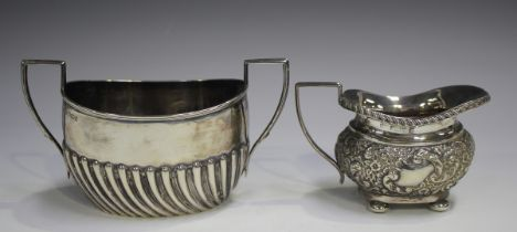 A late Victorian silver two-handled sugar bowl of half-reeded oval form, Sheffield 1900 by