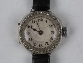 An 18ct white gold and diamond lady's dress wristwatch, the jewelled lever movement detailed '