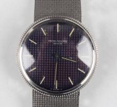 A Patek Philippe Calatrava Automatic 18ct white gold circular cased gentleman's bracelet wristwatch,