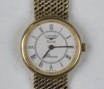 A Longines Quartz Presence 9ct gold lady's bracelet wristwatch, the signed white dial with black