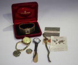 A gold cased keyless wind open-faced fob watch with unsigned movement, gilt base metal inner case,