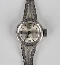 A Tourist white gold and diamond lady's bracelet wristwatch, the signed silvered circular dial