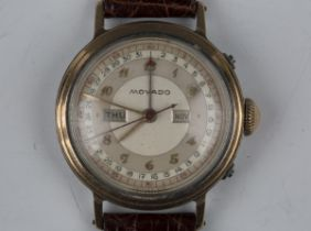 A Movado stainless steel and rose gold triple date calendar gentleman's wristwatch, circa 1940s, the